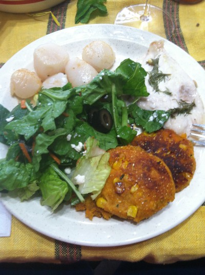 Salad made with CSA lettuce, sweet potato cakes made with local potatoes, scallops and trigger fish from local fishermen.  Photo: After the Knot