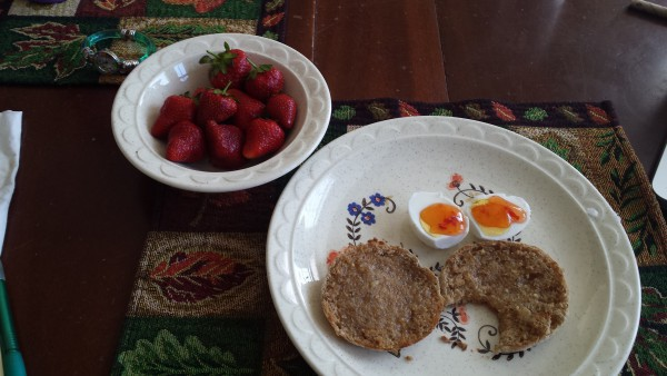 Strawberries, multigrain English muffin with coconut oil and a hardboiled egg with sweet chili sauce. Photo // After the Knot